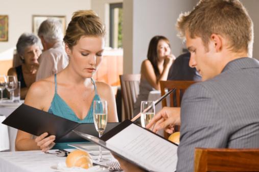 03-22-12-Couple-reading-menus-in-restaurant